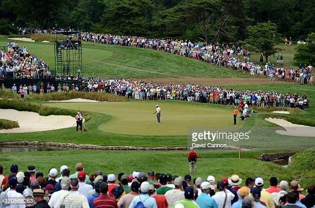 Tiger Woods of the United States misses his putt for birdie on the ninth hole during Round Two of the 113th U.S. Open at Merion Golf Club on June 14,...