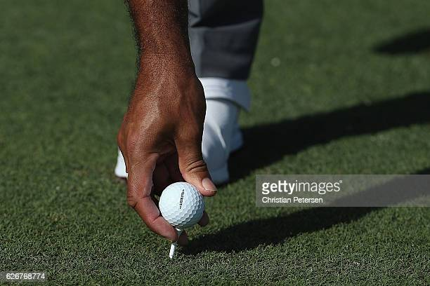 Tiger Woods of the United States places his golf ball during the proam ahead of the Hero World Challenge at Albany The Bahamas on November 30 2016 in...