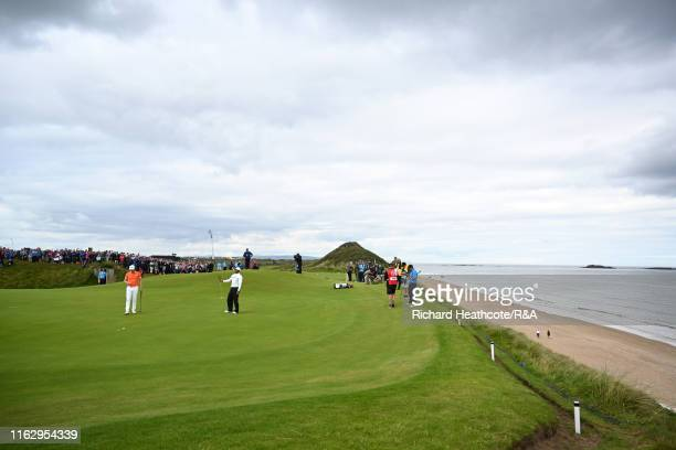 Tiger Woods of the United States plays a putt on the fifth green during the second round of the 148th Open Championship held on the Dunluce Links at...