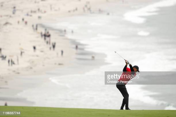 Tiger Woods of the United States plays a second shot on the ninth hole during the final round of the 2019 US Open at Pebble Beach Golf Links on June...