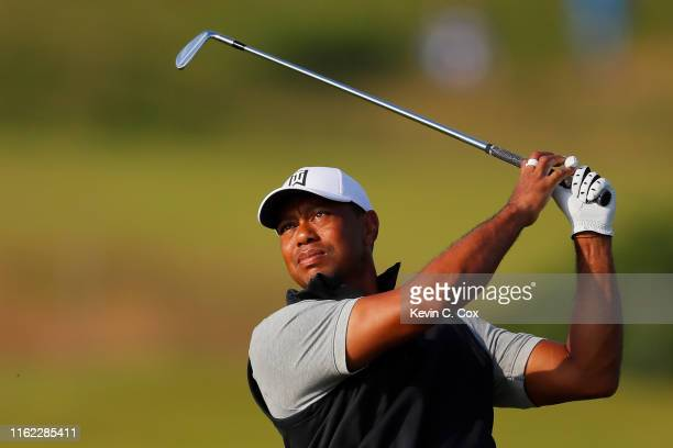 Tiger Woods of the United States plays a shot during a practice round prior to the 148th Open Championship held on the Dunluce Links at Royal...