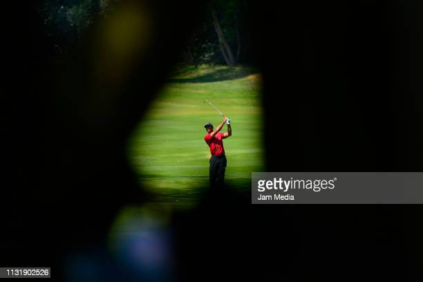 Tiger Woods of the United States plays a shot during the final round of World Golf ChampionshipsMexico Championship at Club de Golf Chapultepec on...