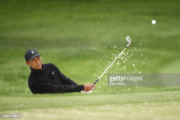 Tiger Woods of the United States plays a shot from a bunker during a practice round prior to the 2020 PGA Championship at TPC Harding Park on August...