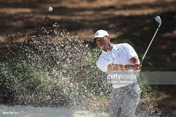 Tiger Woods of the United States plays a shot from a bunker during practice rounds prior to THE PLAYERS Championship on the Stadium Course at TPC...