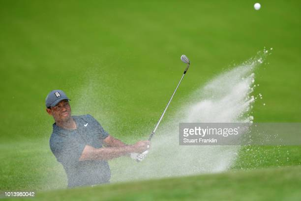 Tiger Woods of the United States plays a shot from a bunker on the fourth hole during the first round of the 2018 PGA Championship at Bellerive...