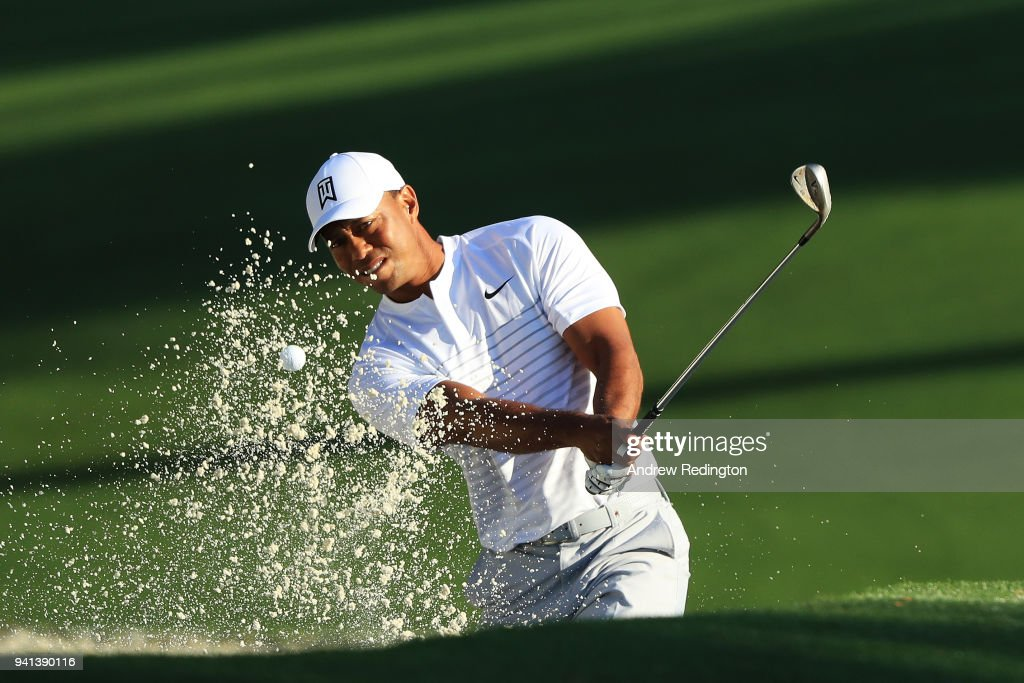 Tiger Woods of the United States plays a shot from a bunker on the tenth hole during a practice round prior to the start of the 2018 Masters Tournament at Augusta National Golf Club on April 3, 2018 in Augusta, Georgia.