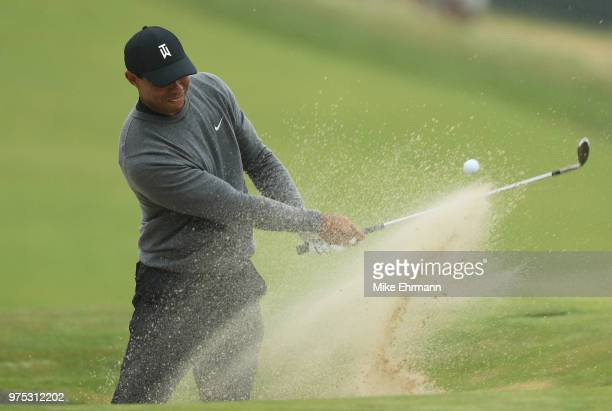Tiger Woods of the United States plays a shot from a bunker on the 15th hole during the second round of the 2018 US Open at Shinnecock Hills Golf...