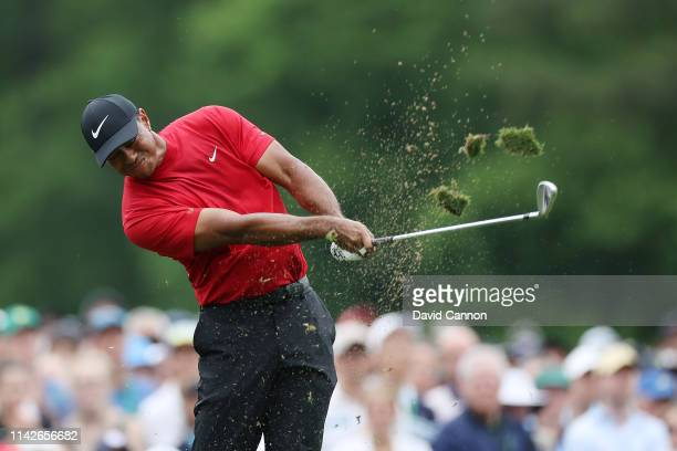 Tiger Woods of the United States plays a shot from the 12th tee during the final round of the Masters at Augusta National Golf Club on April 14 2019...
