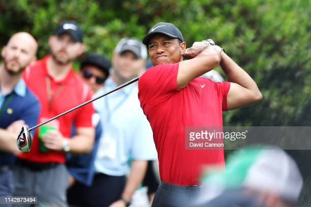 Tiger Woods of the United States plays a shot from the 15th tee during the final round of the Masters at Augusta National Golf Club on April 14 2019...