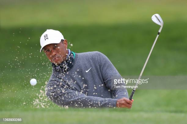 Tiger Woods of the United States plays a shot from the bunker during a practice round prior to the 2020 PGA Championship at TPC Harding Park on...