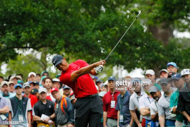 Tiger Woods of the United States plays a shot from the fourth tee during the final round of the Masters at Augusta National Golf Club on April 14...
