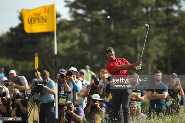 Tiger Woods of the United States plays a shot from the rough on the 11th hole during the final round of the 147th Open Championship at Carnoustie...
