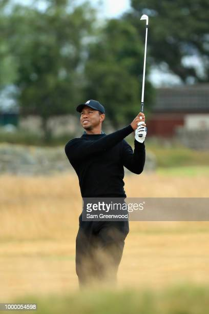 Tiger Woods of the United States plays a shot on a practice round during previews ahead of the 147th Open Championship at Carnoustie Golf Club on...