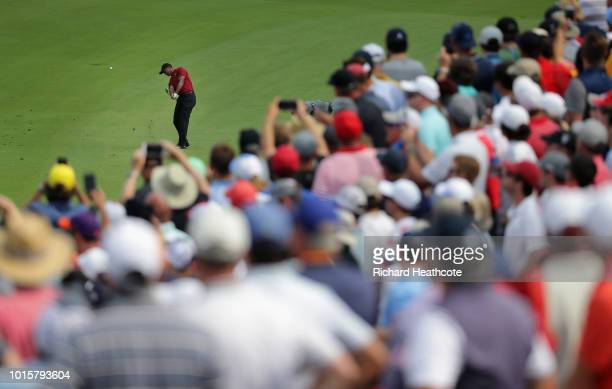Tiger Woods of the United States plays a shot on the 11th hole during the final round of the 2018 PGA Championship at Bellerive Country Club on...