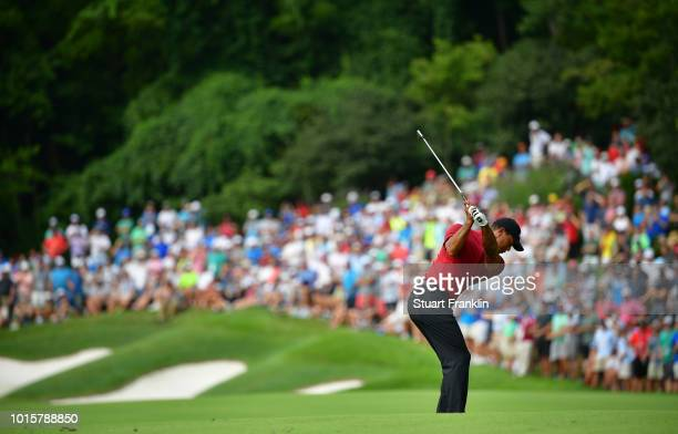 Tiger Woods of the United States plays a shot on the 12th hole during the final round of the 2018 PGA Championship at Bellerive Country Club on...
