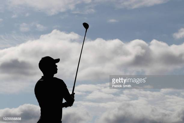 Tiger Woods of the United States plays a shot on the 12th hole during the first round of the Dell Technologies Championship at TPC Boston on August...