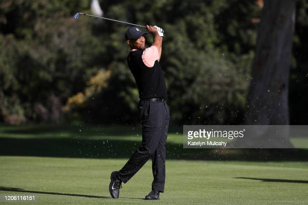 Tiger Woods of the United States plays a shot on the 13th hole during the first round of the Genesis Invitational on February 13 2020 in Pacific...