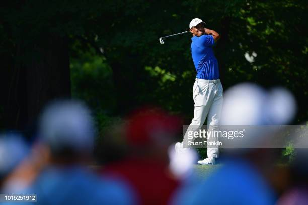 Tiger Woods of the United States plays a shot on the 14th hole during the third round of the 2018 PGA Championship at Bellerive Country Club on...