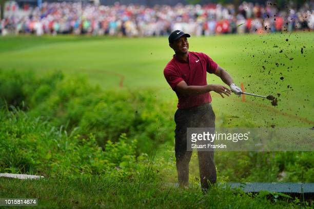 Tiger Woods of the United States plays a shot on the 17th hole during the final round of the 2018 PGA Championship at Bellerive Country Club on...