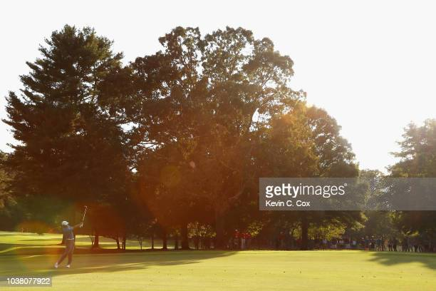 Tiger Woods of the United States plays a shot on the 17th hole during the third round of the TOUR Championship at East Lake Golf Club on September 22...