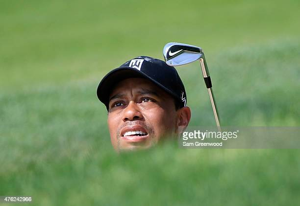 Tiger Woods of the United States plays a shot on the 17th hole during the final round of The Memorial Tournament presented by Nationwide at Muirfield...