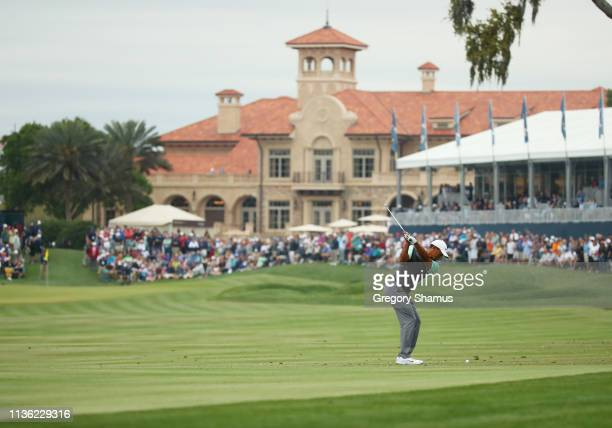 Tiger Woods of the United States plays a shot on the 18th hole during the third round of The PLAYERS Championship on The Stadium Course at TPC...
