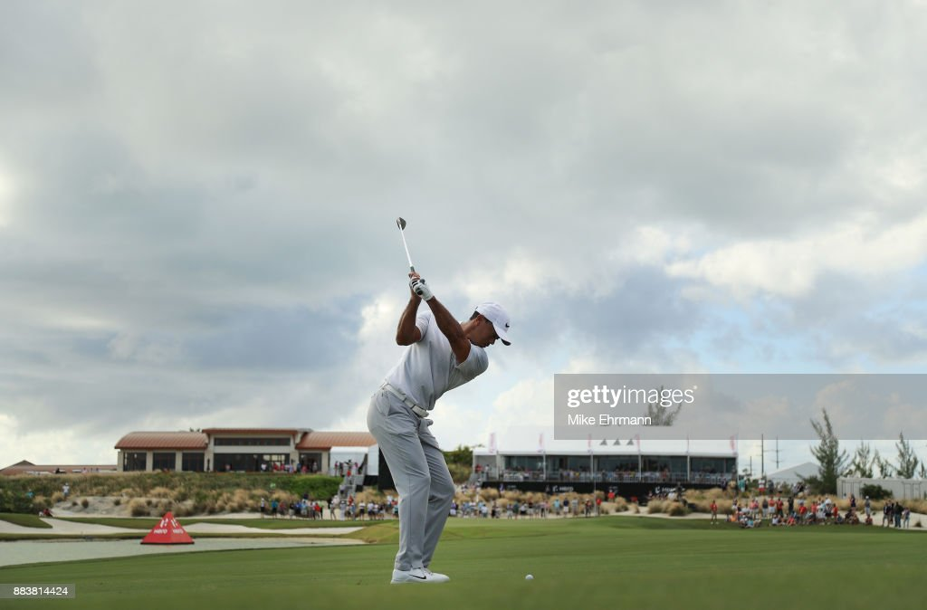 Tiger Woods of the United States plays a shot on the 18th hole during the second round of the Hero World Challenge at Albany, Bahamas on December 1, 2017 in Nassau, Bahamas.