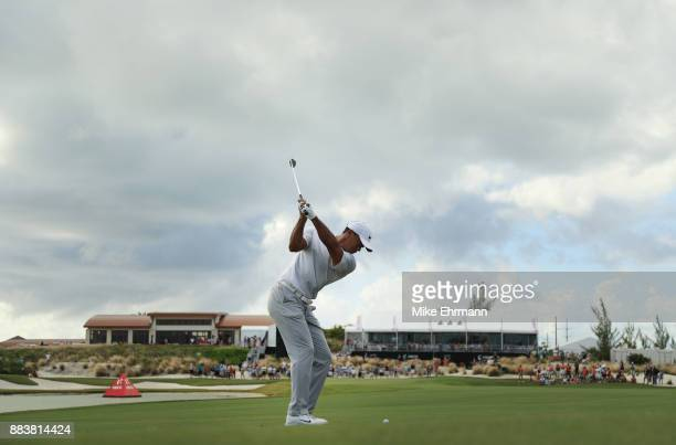 Tiger Woods of the United States plays a shot on the 18th hole during the second round of the Hero World Challenge at Albany Bahamas on December 1...