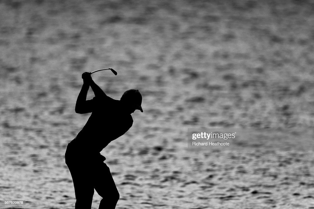 Tiger Woods of the United States plays a shot on the 18th hole during the first round of THE PLAYERS Championship on the Stadium Course at TPC Sawgrass on May 10, 2018 in Ponte Vedra Beach, Florida.