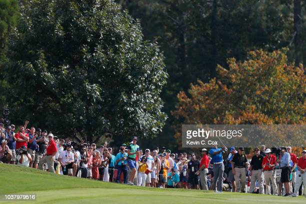 Tiger Woods of the United States plays a shot on the eighth hole during the third round of the TOUR Championship at East Lake Golf Club on September...