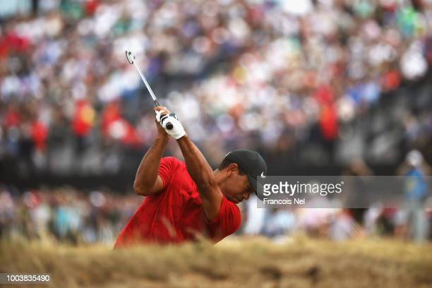 Tiger Woods of the United States plays a shot on the fifth hole during the final round of the 147th Open Championship at Carnoustie Golf Club on July...
