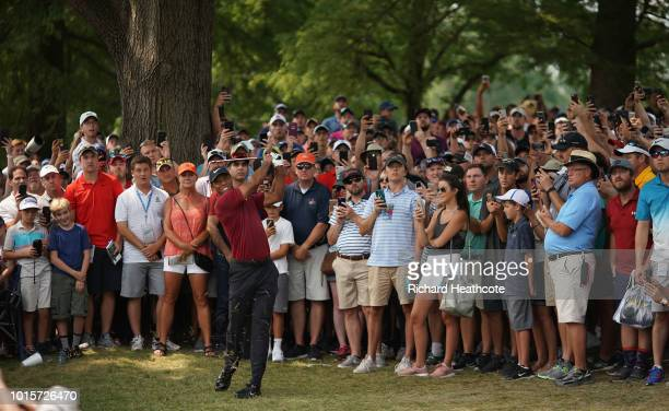 Tiger Woods of the United States plays a shot on the fifth hole during the final round of the 2018 PGA Championship at Bellerive Country Club on...