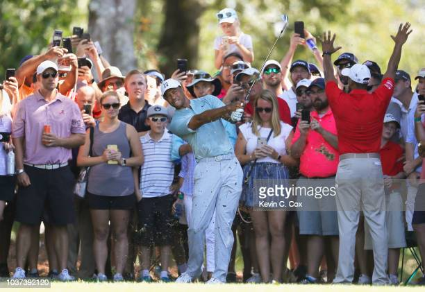 Tiger Woods of the United States plays a shot on the fifth hole during the second round of the TOUR Championship at East Lake Golf Club on September...
