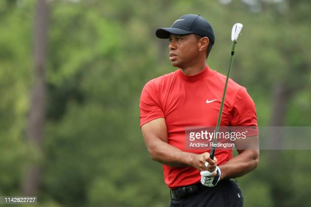 Tiger Woods of the United States plays a shot on the first hole during the final round of the Masters at Augusta National Golf Club on April 14 2019...