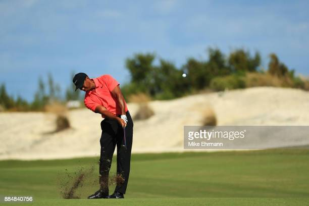 Tiger Woods of the United States plays a shot on the first hole during the final round of the Hero World Challenge at Albany Bahamas on December 3...