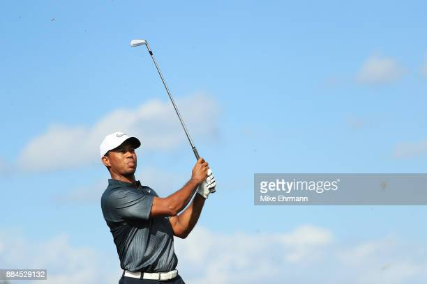 Tiger Woods of the United States plays a shot on the fourth hole during the third round of the Hero World Challenge at Albany Bahamas on December 2...