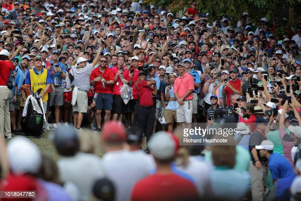 Tiger Woods of the United States plays a shot on the ninth hole during the final round of the 2018 PGA Championship at Bellerive Country Club on...
