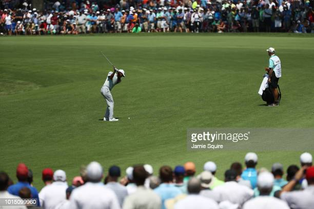 Tiger Woods of the United States plays a shot on the second hole during the third round of the 2018 PGA Championship at Bellerive Country Club on...