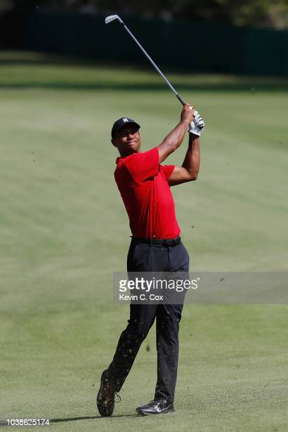 Tiger Woods of the United States plays a shot on the seventh hole during the final round of the TOUR Championship at East Lake Golf Club on September...