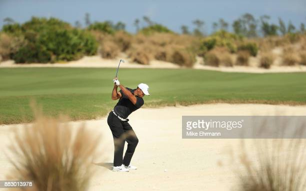 Tiger Woods of the United States plays a shot on the sixth hole during the first round of the Hero World Challenge at Albany Bahamas on November 30...