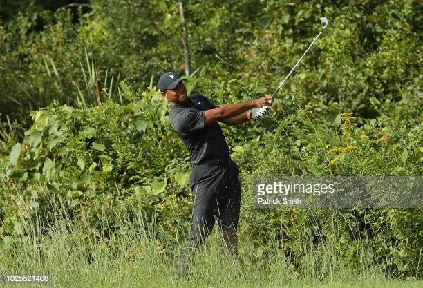 Tiger Woods of the United States plays a shot on the tenth hole during the first round of the Dell Technologies Championship at TPC Boston on August...
