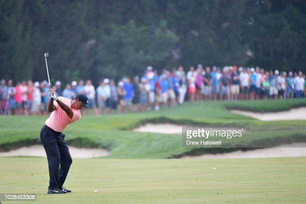 Tiger Woods of the United States plays a shot on the third hole during the second round of the BMW Championship at Aronimink Golf Club on September...
