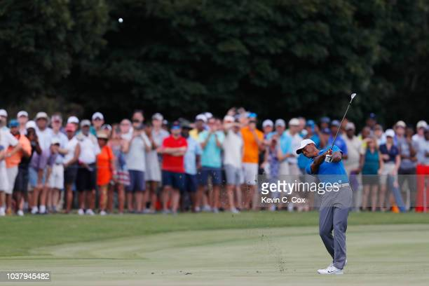 Tiger Woods of the United States plays a shot on the third hole during the third round of the TOUR Championship at East Lake Golf Club on September...