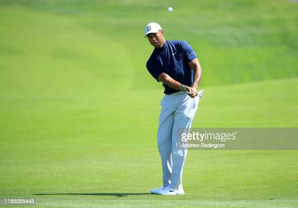 Tiger Woods of the United States plays an approach shot during a practice round prior to the 2019 U.S. Open at Pebble Beach Golf Links on June 10,...