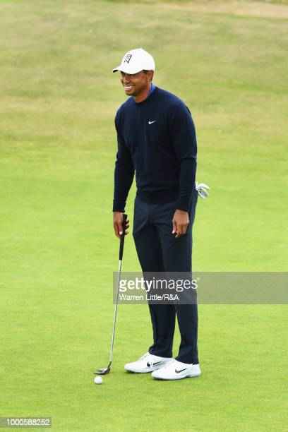 Tiger Woods of the United States plays at the 1st hole green while practicing during previews to the 147th Open Championship at Carnoustie Golf Club...