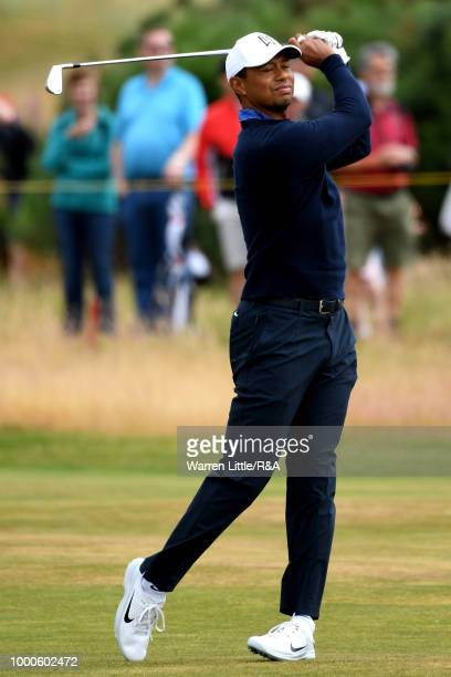 Tiger Woods of the United States plays at the 4th hole while in a practice round during previews to the 147th Open Championship at Carnoustie Golf...