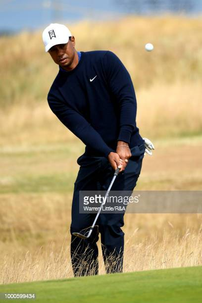 Tiger Woods of the United States plays at the 5th hole while in a practice round during previews to the 147th Open Championship at Carnoustie Golf...