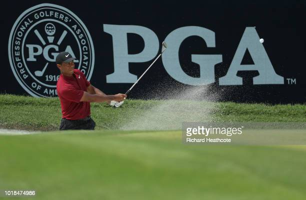 Tiger Woods of the United States plays from a greenside bunker on the sixth hole during the final round of the 2018 PGA Championship at Bellerive...