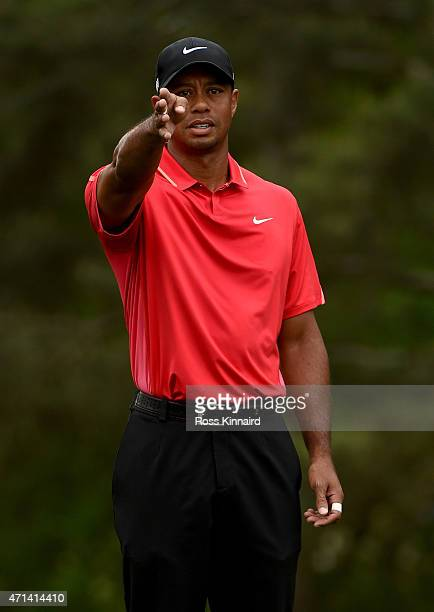 Tiger Woods of the United States plays from the 9th fairway while playing his first hole during the final round of the 2015 Masters at Augusta...