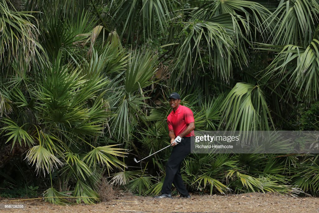 Tiger Woods of the United States plays from under the trees on the 2nd during the final round of THE PLAYERS Championship on the Stadium Course at TPC Sawgrass on May 13, 2018 in Ponte Vedra Beach, Florida.